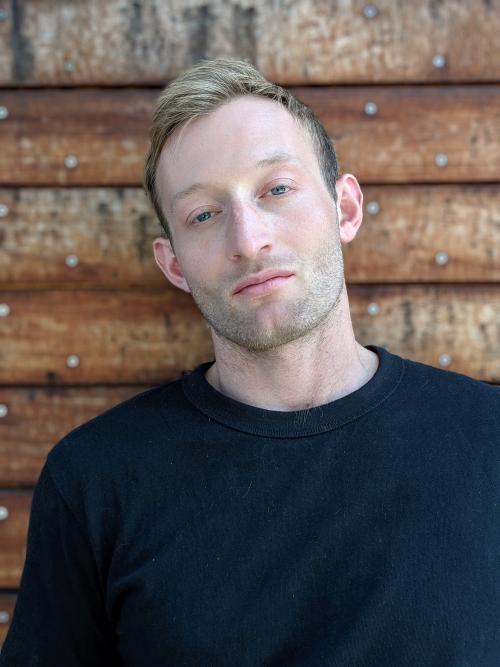 Headshot of Noah Warren
